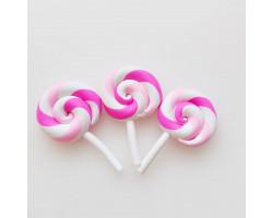 Леденец на палочке нежно-розовый