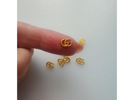 Значок логотип Gucci золото