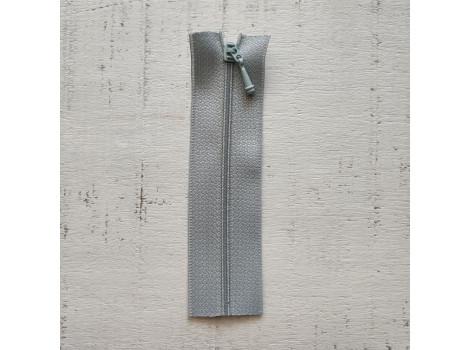 Молния вшивная 7 см серо-голубая