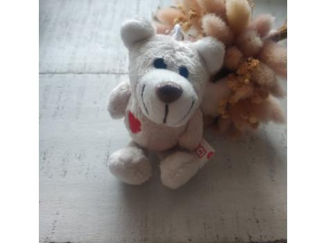 Игрушка Nici медвежонок белый гладкий с сердечком