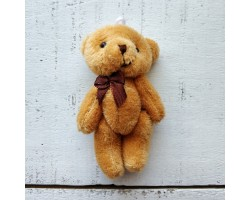 Игрушка мишка с бантиком коричневый