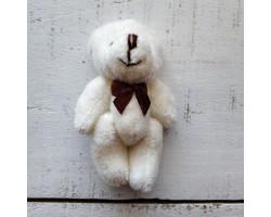 Игрушка мишка с бантиком белый