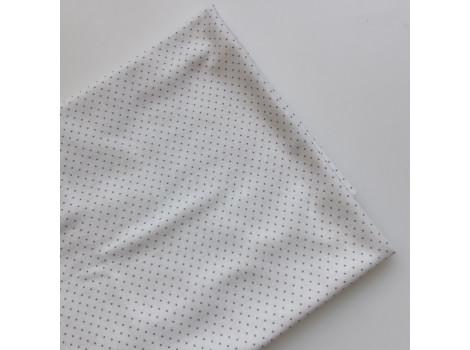 Трикотаж кулирка горошек-пшено тауп на молочном фоне